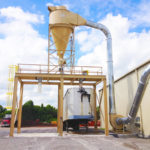Cyclone Dust Collector on top of a Double Truck Load-out System by Dust Collection Services LLC