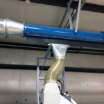 """Blue 12"""" DCS Zipper Duct and Slider attached to machine"""